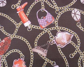 "W072C - Vinyl Waterproof Fabric - Chain/boot/handbag on brown - 27"" x 19"" (70cm x 50cm)"