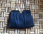 Gorgeous vintage black clutch purse by Ande