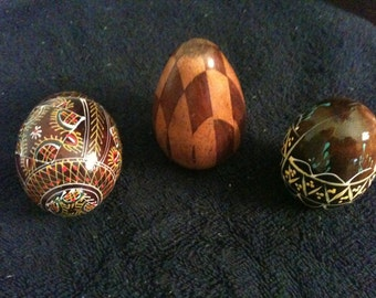 three wooden handcrafted eggs