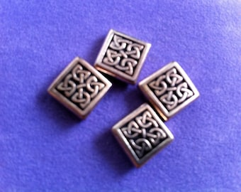 Silver beads with asian or celtic ethnic flair