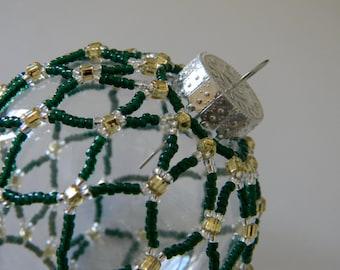 Dark green hand-sewn beaded ornament