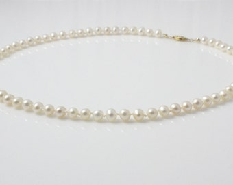 White Lotus Freshwater Cultured Pearl Necklace - White Hand Knotted Pearls with Gold Filled Clasp - Matinee Length