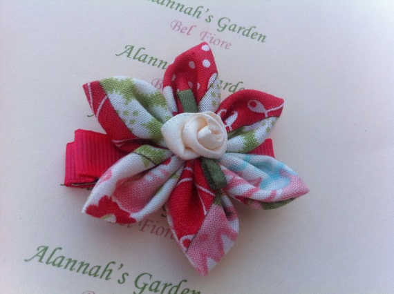 Hair clip with a Red, Pink and White Floral Fabric Flower
