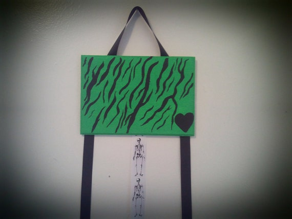 green zebra bow holder