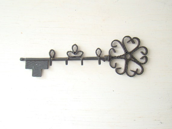 vintage skeleton key shaped key rack painted black with 4 hooks