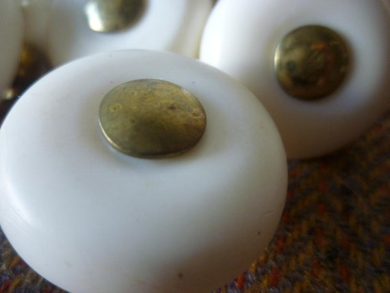 70's retro plastic cupboard knobs with brass feature