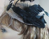 """Cocktail """"Half"""" Hat with feather bird"""