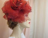 Lady in Red Tops her Outfit with this Huge Silk Flower