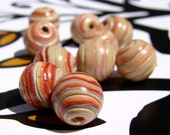Handmade Cherry Red and Almond Spiral Beads