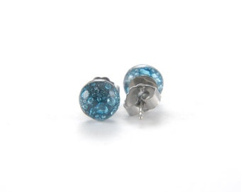 Turquoise blue fused glass stud earrings full of tiny bubbles with surgical steel posts