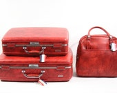 Three Ruby Red Suitcases