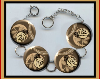 DAUGHTERS of the NILE Altered Art Button Charm Bracelet with Rhinestone