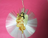 Antique Christmas Ornament of spun glass with angel.