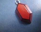 Brick Red Rupee Charm