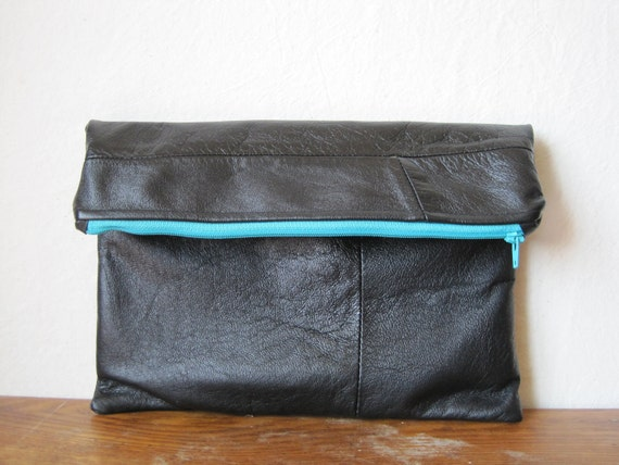 black leather clutch with turquoise zipper and interior