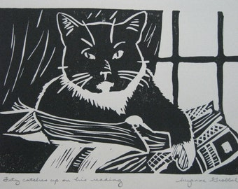 "Cat and books block print - ""Fitz catches up on his reading"""