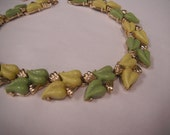 Coro Vintage Thermo Necklace in gold tones with lime green and yellow leave design