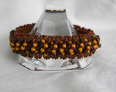 Tribal ... beadwoven bracelet beaded peyote bangle earthy autumn harvest rustic apricot tangerine rootbeer brown round circle hoop
