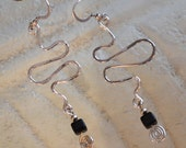 Long Sterling Silver and black dangle earrings.  S curved squiggles   hand forged.