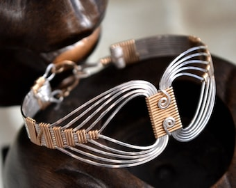 Egyptian wire wrapped Bracelet with a Twist.  Sterling Silver and 14K Gold filled.