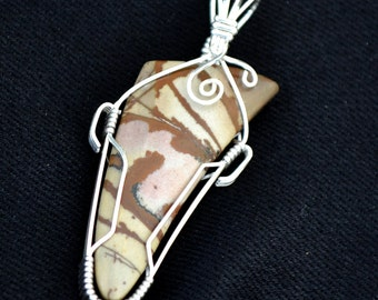 Owyhee jasper stone pendant.  Sterling Silver wire wrapped.