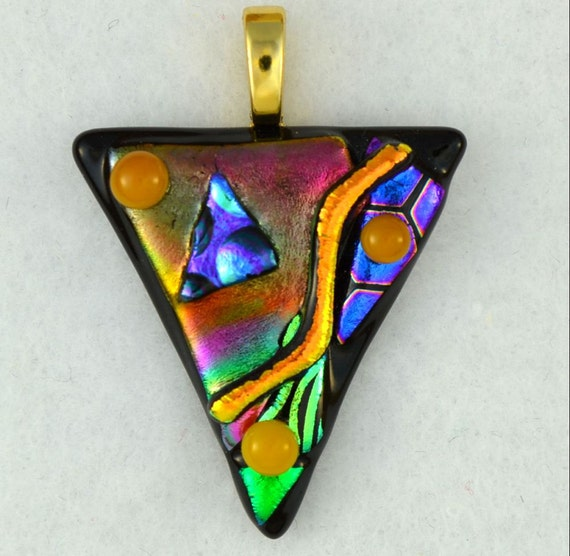 Dichroic fused glass pendant. Whimsical and colorful with gold bail.  'dancing colors'