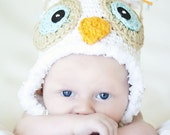 White owl hat with tiffaney blue eyes and furry border