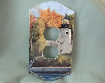 Art print of White River Lighthouse on plug cover