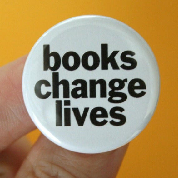 books change lives.  1.25 inch button pin. so read something awesome.