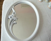 NEW LISTING----a Syroco oval mirror with a spray of flowers across the  mirror   Teasury item