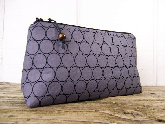 Cosmetic bag in modern black and gray print , perfect for giftgiving.