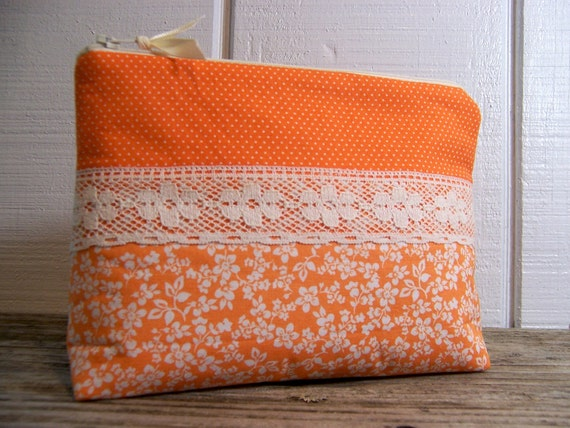 Cosmetic bag in happy orange with vintage lace.
