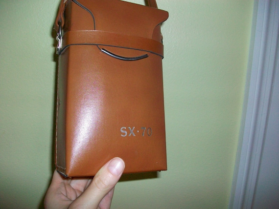 1970s sx-70 leather case in perfect condition with original sx-70 imprint on leather