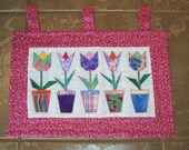 A cute appliqued tulip wall hanging