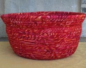 Fabric coiled round red basket