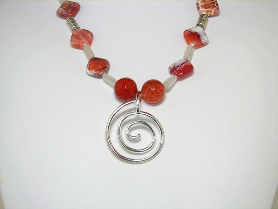 A Necklace of Fire Agate and Quartz Crystal Accented with Silver Beads and a Spiral Pendant with FREE Matching Earrings