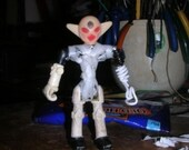 The Toys Doctor. This robot had only his head, right harm and legs left. Now he's happy.