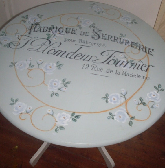 kitchen dining table with hand-painted white roses and vintage French typography.