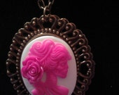 Bright pink and white skeleton girl cameo necklace