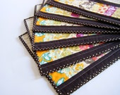 """Quilted Placemats - Sandi Henderson """"Meadowsweet"""" fabrics - red, yellow, pink - set of 6"""