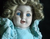 Porcelain Collectible Doll Blue Eyed Girl with Blue Dress
