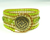 Green cuff bracelet - lime green on brown leather- celtic knot bronze closure.