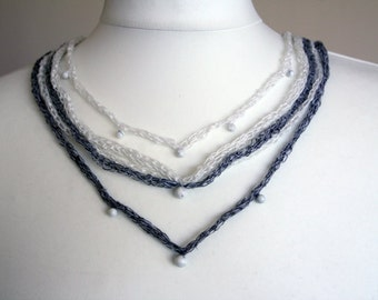Discount 32%   Knitted linen necklace with natural stone howlite