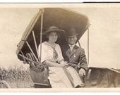 Vintage/Antique photo of a couple in a horse carriage
