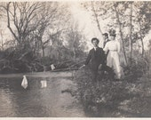 Vintage/Antique photo of two men and a woman near a creek or a river