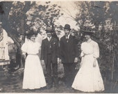 Vintage/Antique photo of women in dresses and men in suits