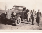 Vintage/Antique photo of a man, two women and a Dodge farm truck