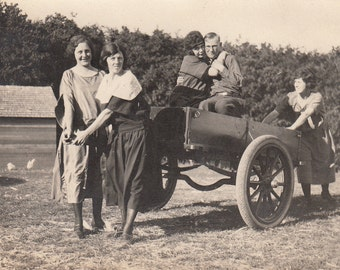Vintage/Antique photo of 4 women and 1 man playing goofing around
