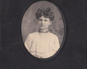 Vintage/Antique Cabinet photo of beautiful woman with a wonderful bow in her hair