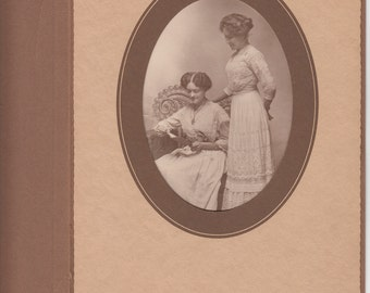 Vintage/Antique cabinet  photo of two women in beautiful dresses